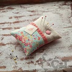 cute idea for a pin cushion.....i bet you could get some thread, needles and other small sewing items, put them in a mason jar with a rafia bow and a cute card for a gift for someone