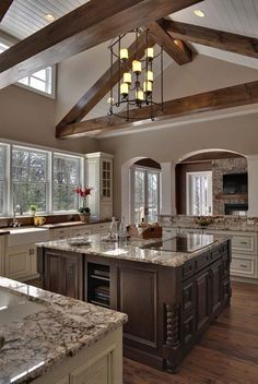 I love the dark wood in this, and I love the island space. I always dream of having a big island, this would be my dream kitchen