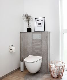 Unusual look for a minimalist Scandinavian bathroom with an industrial touch.