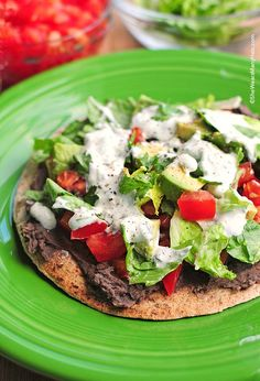 These delicious Black Bean Tostadas with Cilantro Sauce are full of flavor and a healthier choice for a meal or even served up as appetizers. They are quick to make too! shewearsmanyhats.com