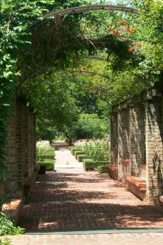 The New Orleans Botanical Garden contains lush plants and mature oaks.