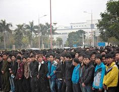 An estimated 3000 migrant workers showed up on a Monday morning outside the gates of the Foxconn recruitment center in Shenzhen, China hoping to qualify for a job with the electronics giant.