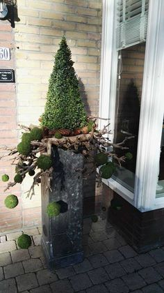 Yule style! Modern idea for Front door entrance Yule/ Christmas/Holiday /Winter arrangements! Would look wonderful in front of a home, restaurant, hotel or commercial office!