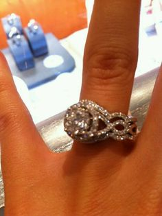 Engagement ring + wedding bands- love the twist! #Rings