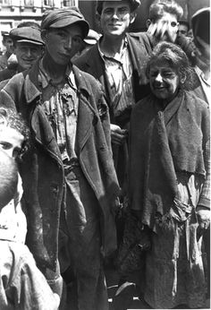 Warsaw, Poland, Jews dressed in rags. The population of the ghetto, increased by Jews compelled to move in from nearby towns, was estimated to be over 400,000 Jews. German authorities forced ghetto residents to live in an area of 1.3 square miles, with an average of 7.2 persons per room.