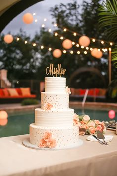 Four,+Tiered+Ivory+Wedding+Cake+with+Peach+Floral+Accent+and+Mr+and+Mrs+Cake+Topper