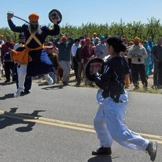 Gatka Master and Student Demonstrate Sparring in the Hola Mohalla Parade