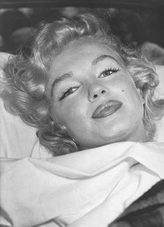 .Marilyn photographed leaving hospital after having an ectopic pregnancy, 1957.  She knew how to smile even when she was sad and that's important.
