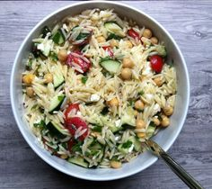 Summer Orzo Pasta Salad - a delicious pasta salad mixing zucchini, tomatoes, mint, basil, feta, and a lemon/red wine vinaigrette. Summer in a bowl! // A Cedar Spoon