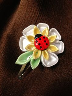 Lady bug on a daisy flower hair clip by Flowersontop on Etsy, $4.95