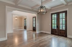 Light floors with dark doors and white trim Dark Wood Trim, White Wood Floors, White Trim Wood Doors, Hardwood Floors, Flooring, Dark Doors, Brown Doors, Stained Trim, Doors And Floors