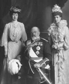 Queen Alexandra (right), with Princess Victoria (left) and King Edward VII (seated)