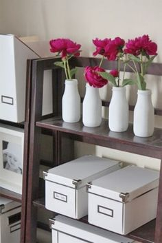 starbucks bottles...spray painted. Do this on one of my floating shelves...