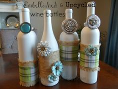 Embellished Upcycled Wine Bottles - Easity transform empty wine bottles into these adorable decorations!    All you need: spray paint, hot glue gun, burlap, rib…