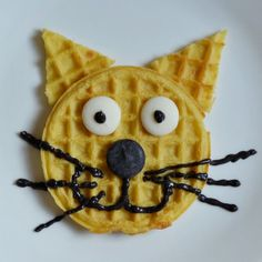 Cat shaped waffle. You could always create something similar with a pancake. Lovely breakfast idea!