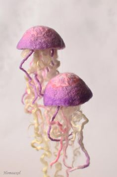 Felted jellyfish. Can be hung from the ceiling.