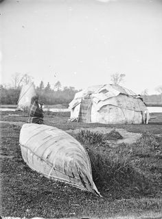 Ho-Chunk Indian with Canoe and Wigwams | Photograph | Wisconsin Historical Society
