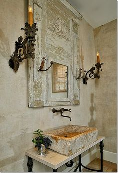 The candlestick holders add to the rustic charm of this space.