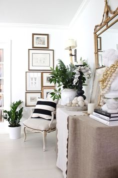 #1 Start a gallery wall arrangement by using a small to medium-sized round mirror as the anchor.  One Kings Lane     #2 Hang a smaller rug as a colorful, textural piece of art. Rue Mag     #3 Forget about perfect spacing between frames, and hang your gallery wall tightly together for impact. Design …