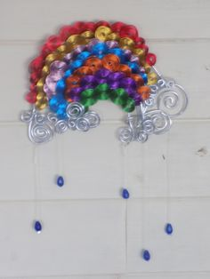 How about a totally wire rainbow. With sapphire rain drops?    You can find me on facebook https://www.facebook.com/Theshinyzone