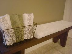 DIY bathroom bench would also be a great idea so things don't end up on the floor. Would be great across from toilet.