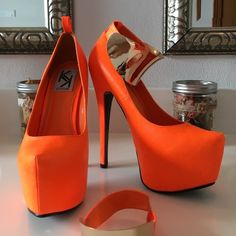 Bright Orange Platform Pumps Bright Orange Kiss Kouture Nicole.  6 inch heel with two inch platform.  Removable faux brass ankle cuff.   Gently worn with a few bumps and bruises. Kiss Kouture Shoes Heels