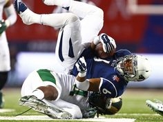 Nevada Wolf Pack running back Don Jackson is tackled by Colorado State Rams linebacker SteveO Michel in the first half of the Arizona Bowl in Tucson, Ariz. Nevada won 28-23.  Mark J. Rebilas, USA TODAY Sport