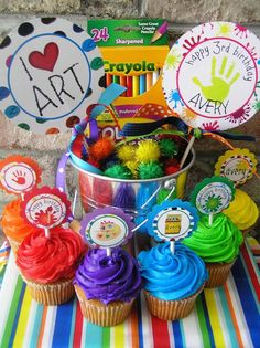 """Art Birthday Party Package  Assembled and by HandmadePartyCo, $137.50 - cupcakes in paint colors, chocolate """"A"""" stuck in the top"""