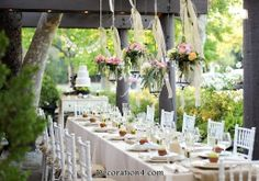2014 wedding reception trends | Keeping your centerpieces simple and hang flowers and candles above the table.  Ceiling decor can be quite captivating and dramatic.