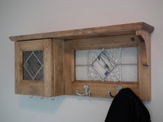 Duo coat racks and wall cabinet to key with stained glass and