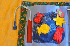 This site has a lot of quiet book ideas.  I like the magnetic fishing page and the oven mitt page.