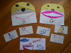 """Feeding the Seals became a mainstay in our schooling. I had a bucket of """"fish"""" (3 x 5 cards) and my kids had to decide which fish could be fed to which seal. I learned to put clear tape on the front of my seals so that I could change their purpose from one day to the next (wet erase markers). So in this example, the seals can only eat words that begin with the letter on their fronts. This game could review any topic we wanted. From Carol Barnier, Sizzle Bop"""