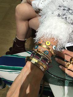 Helena Bordon's arm party during Paris fashion week via Man Repeller