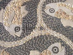 pebble mosaic fish | Fish symbol made from stones on a pavement in Swanage, Dorset