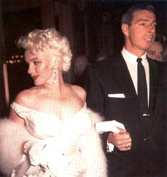 "Marilyn Monroe and Joe DiMaggio at the premiere of ""The Seven Year Itch"" at the Loew's State Theater, 1955."
