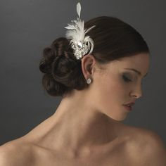 Rhinestone Floral Galore Bridal Feather Hair Brooch & Fascinator can be inserted into the side of an elegant up do, or pinned to a gown for a touch of elegant sparkle.