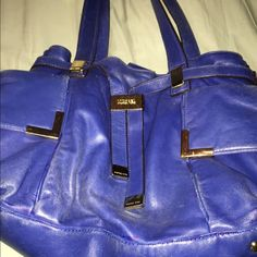 Authenic  Michael Kors purse sale Authentic blue soft as butter leather Michael Kors purse. Big pockets on both sides. Draw pull up with a snap on the inside. Big pockets inside with a zipper pocket. KORS Michael Kors Other