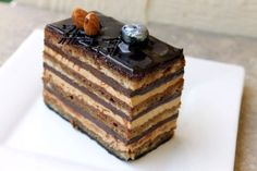 An amazing French cake that uses one of the most loved blends of flavors: chocolate and coffee.  Almond sponge cake is soaked in a rich coffee sauce and layered with mocha butter cream and a chocolate ganache. A chocolate spread tops of the cake. The coffee flavor is subtle; the chocolate layer so smooth it melts in your mouth.