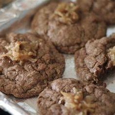 "German Chocolate Thumbprint Cookies | ""A chewy chocolate cookie topped with a German chocolate icing. Very good, and they freeze wonderfully if you have any left to freeze. Do not substitute canned frosting or you will be disappointed."""