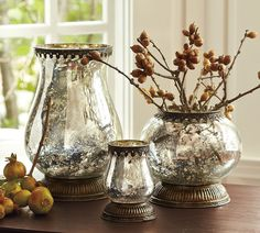"""DIY IDEA for making plain vases into mercury glass.  Spray the glass with water and then spray with Krylon """"Looking Glass"""" paint.  A visit to the """"everything's a $1"""" store could result in really cool decorations for rooms in my home!"""