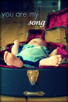 You are daddy's most previous Song -  Baby photography with Guitar theme