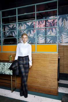 Not into the ruffle collar, but I love the look of a structured white shirt with plaid print slacks!