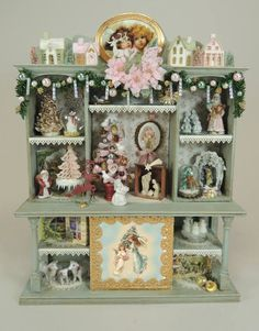The shabby chic hutch includes two different artwork sets. the santa and this one featuring angels and cherubs