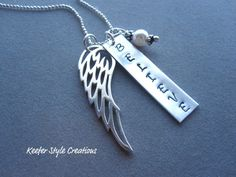 Hand Stamped Believe necklace with large angel wing charm. $45.00, via Etsy.
