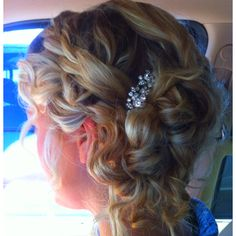My prom hair this year! Spiral curled and pinned into a loose bun on one side.