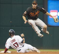 J.J. Hardy jumps over Shin-Soo Choo after a double play at Progressive field
