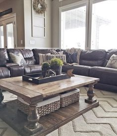 living room with gray walls, brown leather couch, white fireplace ...