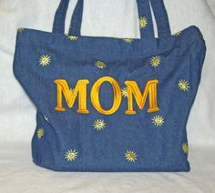 PIN IT TO WIN IT!  Winner will be chosen on July 4, 2012.  Denim bag will be embroidered with MOM or your initials.  www.AGiftToTreasure.com