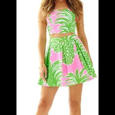 Lilly Pulitzer Pink Flamenco Parfait Set FREE GWP! NWT Lilly Pulitzer Pink Flamenco Parfait crop set. Sold out from Lilly Pulitzer. Adorable pink and green pineapple print. Purchase and receive FREE GIFT WITG PURCHASE! Lilly Pulitzer Dresses