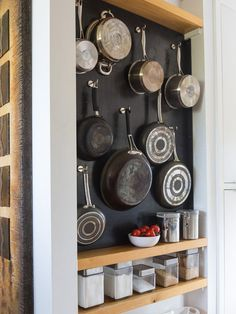 Tired of your pans hanging above your kitchen counter? Well, you can now hang it one by one on your wall. It's really stylish and convenient. Plus keep those food materials in glass containers so you can organize it well.